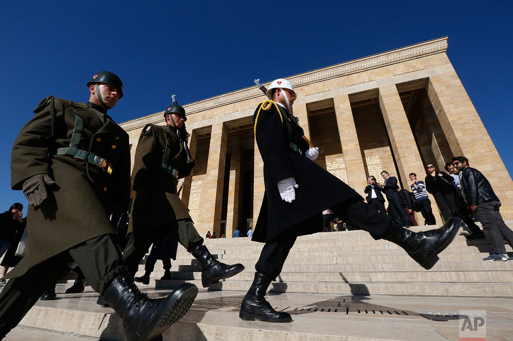"In this March 29, 2017 photo, Turkish military honour guards perform the hourly changing of the guard at the mausoleum of Mustafa Kemal Ataturk, the founder of modern Turkey in Ankara, Turkey. The legacy of the man whose surname means ""father of Turks"" was one of a modern, secular, western-leaning Turkey. But the personality cult that grew around him has very gradually been fading as current President Recep Tayyip Erdogan, in power since 2003 as alternately prime minister and president, has harked back to the glory days of the height of the Ottoman Empire to whip up patriotic sentiment. (AP Photo/Lefteris Pitarakis)"