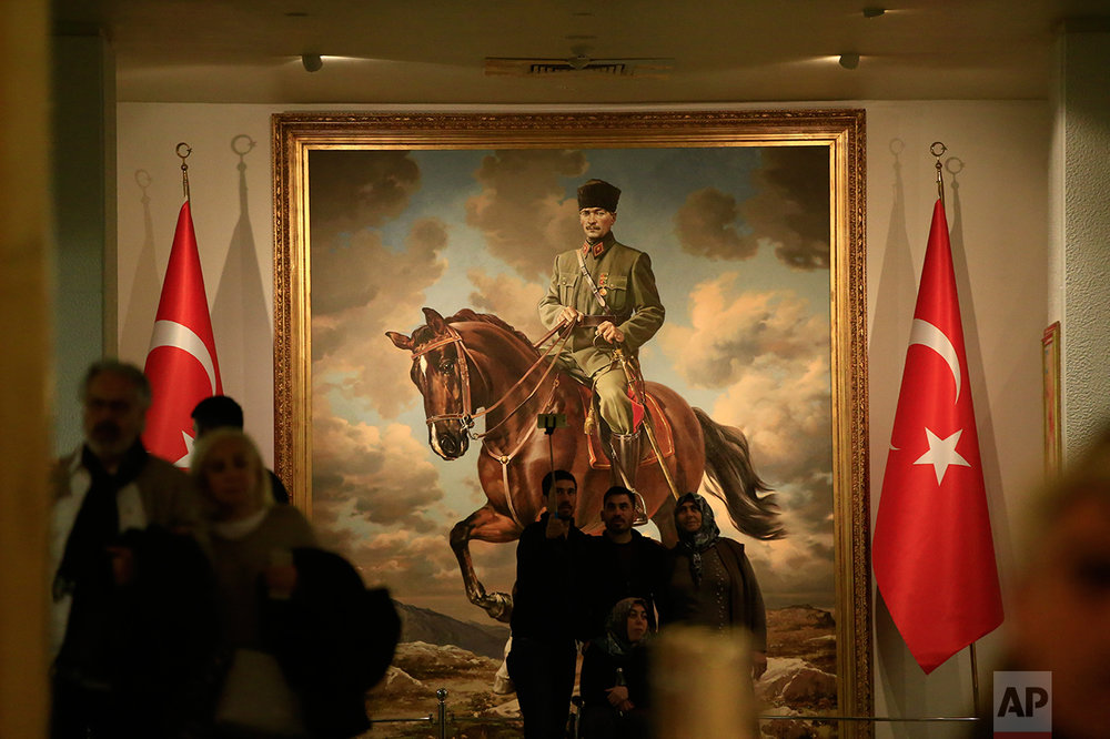 In this March 29, 2017 photo, a painting of Mustafa Kemal Ataturk, the founder of modern Turkey is exhibited at the museum addict to his mausoleum in Ankara, Turkey. Ataturk' mausoleum, a sprawling complex built in the early 1950s in the Turkish capital, is still a place of pilgrimage for many. Families, schoolchildren, elderly people, veiled Muslim women all come to pay homage to his memory. (AP Photo/Lefteris Pitarakis)