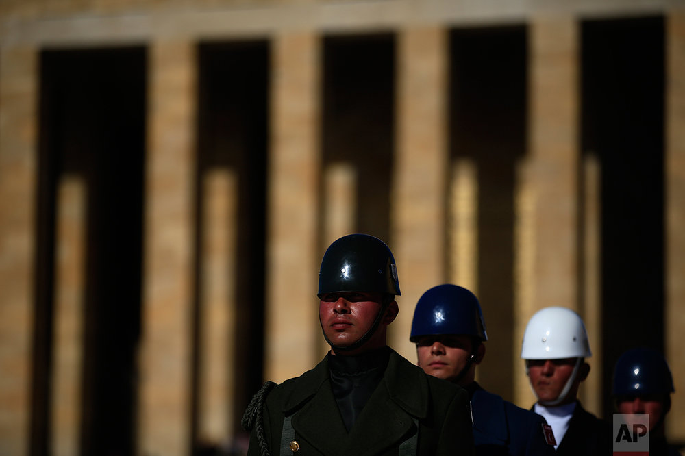 "In this March 29, 2017 photo, Turkish military honour guards perform the hourly changing of the guard at the mausoleum of Mustafa Kemal Ataturk, the founder of modern Turkey in Ankara, Turkey. The legacy of the man whose surname means ""father of Turks"" was one of a modern, secular, western-leaning Turkey. (AP Photo/Lefteris Pitarakis)"
