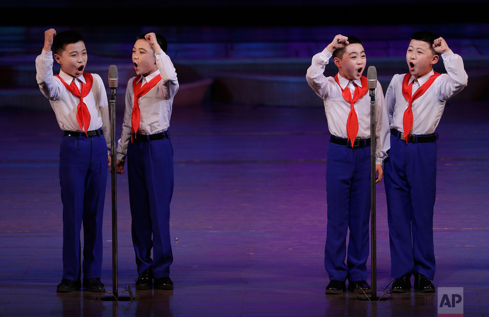 Schoolboys sing at the Mangyongdae Children's Palace on Friday, April 14, 2017, in Pyongyang, North Korea. Amid rising regional tensions, Pyongyang residents have been preparing for North Korea's most important holiday: the 105th birth anniversary of Kim Il Sung, the country's late founder and grandfather of current ruler Kim Jong Un. (AP Photo/Wong Maye-E)