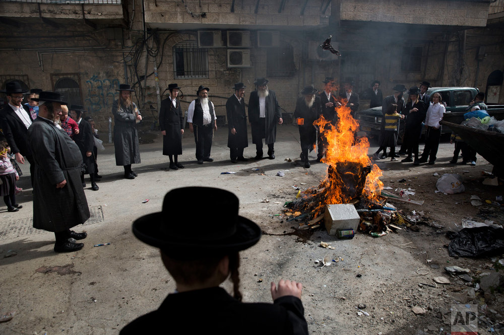 Ultra-Orthodox Jews burn leavened items in final preparation for the Passover holiday in Jerusalem, Monday, April 10, 2017. Jews are forbidden to eat leavened foodstuffs during the Passover holiday that celebrates the biblical story of the Israelites' escape from slavery and exodus from Egypt. (AP Photo/Oded Balilty)