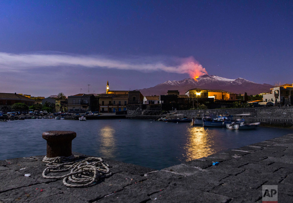 Snow-covered Mount Etna, Europe's most active volcano, spews lava during an eruption seen from the Sicilian village of Pozzillo, Italy, in the early hours of Tuesday, April 11, 2017. (AP Photo/Salvatore Allegra)