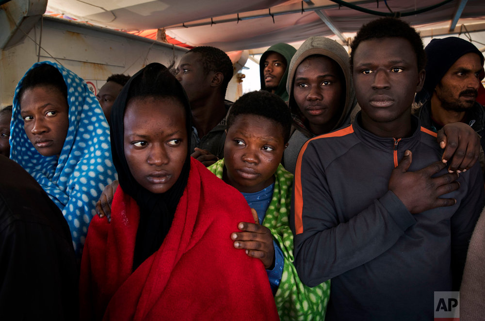 Migrants aboard the Golfo Azurro rescue vessel wait to be transferred to Italian authorities in Trapani harbor, on the Italian island of Sicily, Saturday, April 8, 2017. Most migrants on the Mediterranean are now trying to reach Italy. Those numbers have dramatically increased since the European Union and Turkey signed an agreement last year that allowed Greece to send new asylum-seekers back to Turkey. (AP Photo/Bernat Armangue)
