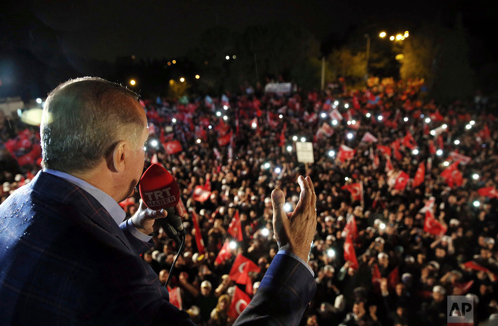 Turkey's President Recep Tayyip Erdogan addresses cheering supporters after unofficial referendum results were announced, in Istanbul, late Sunday, April 16, 2017. (Yasin Bulbul/Presidential Press Service via AP)