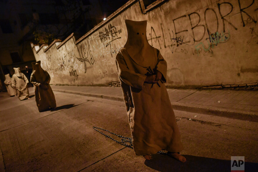 "In this Tuesday, April 11, 2017 photo, 'Ensacados'' or masked penitents take part in the procession of the ""Silencio del Santisimo Cristo del Rebate"" brotherhood, during Holy Week in Tarazona, northern Spain. (AP Photo/Alvaro Barrientos)"