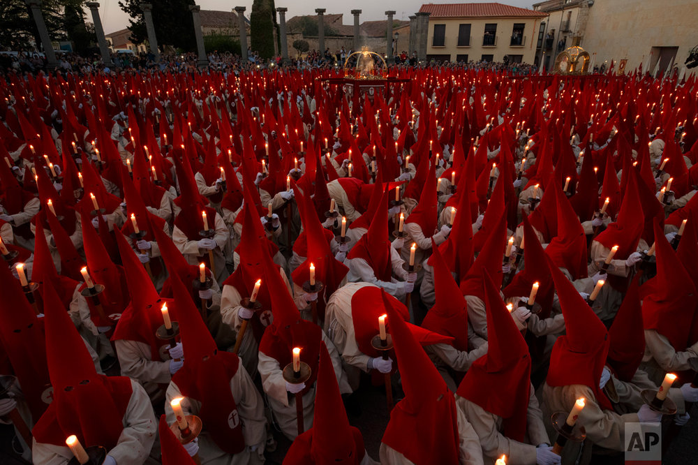 In this Wednesday, April 12, 2017 photo, penitents from 'Real Cofradia del Santisimo Cristo de las Injurias' also known as 'El Silencio' brotherhood take part in a procession in Zamora, Spain. (AP Photo/Daniel Ochoa de Olza)