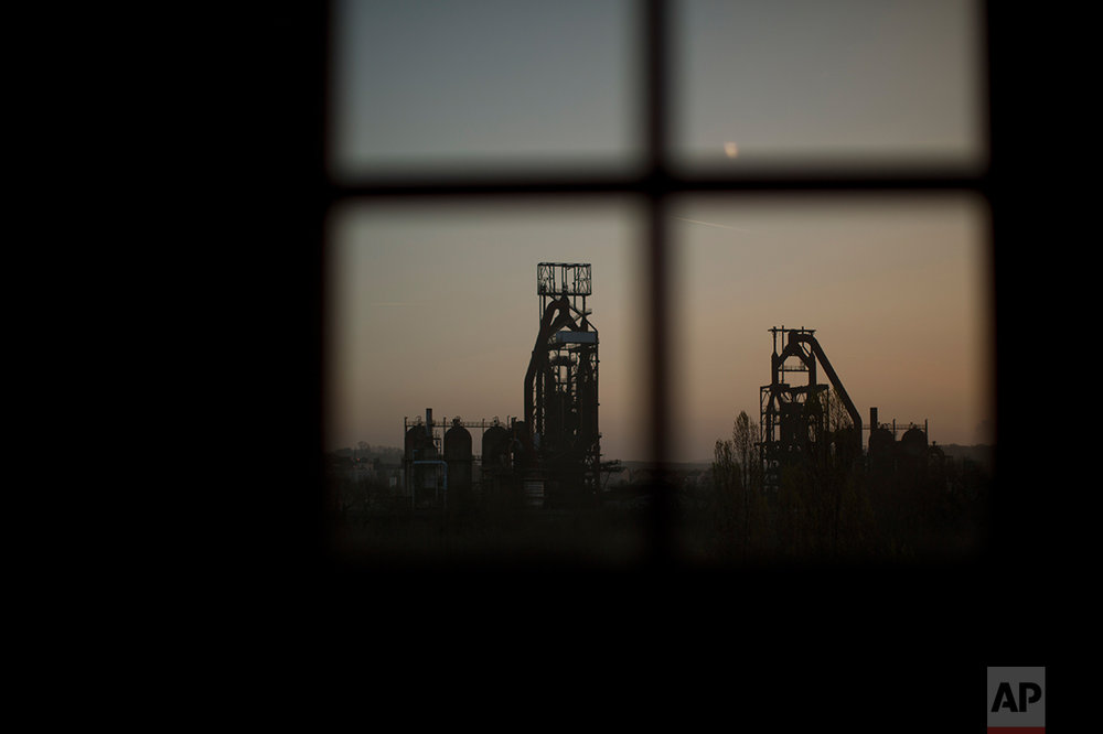 An abandoned steelworks with blast furnaces. (AP Photo/Emilio Morenatti)