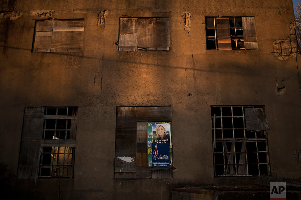 An electoral poster showing Marine Le Pen is pasted on a wall of an abandoned factory on the outskirts of Hayange. (AP Photo/Emilio Morenatti)