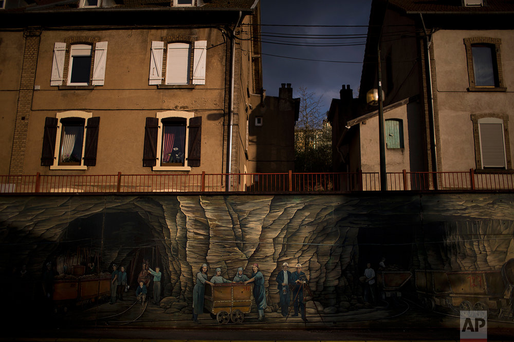 A mural depicting miners is displayed along one of the main streets of Hayange. (AP Photo/Emilio Morenatti)