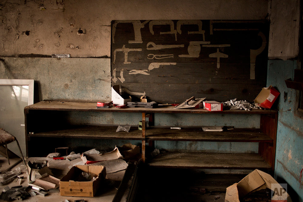 In this Monday April 3, 2017 photo, a former repair shop inside an abandoned industrial unit at Hayange, a commune in the Moselle department in Grand Est in north-eastern France.  (AP Photo/Emilio Morenatti)