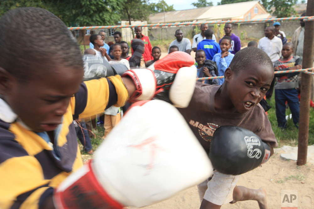 In this Sunday, March 11, 2017 photo, children fight in a boxing ring in Chitungwiza, Zimbabwe. (AP Photo/Tsvangirayi Mukwazhi)