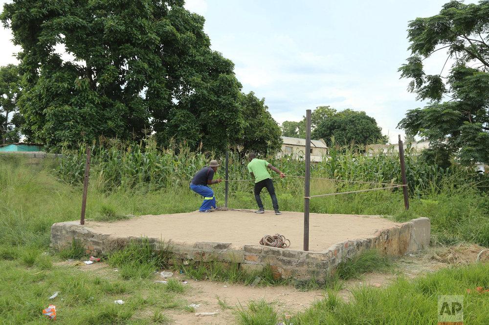 In this Saturday, Feb. 12, 2017 photo, organisers set up a boxing ring in Chitungwiza, Zimbabwe. (AP Photo/Tsvangirayi Mukwazhi)
