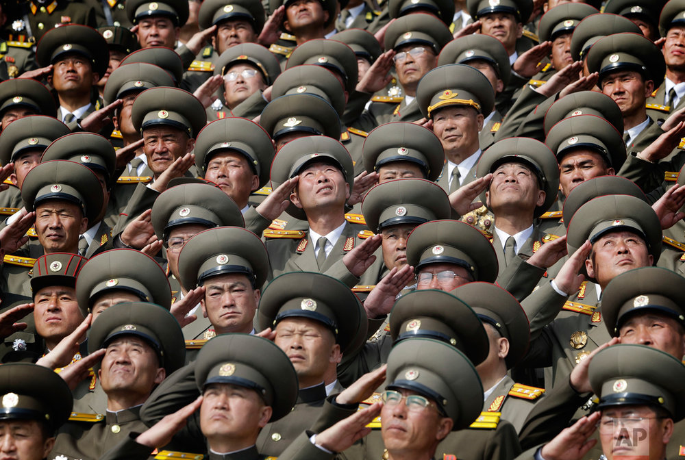 Soldiers salute as the national anthem is played during a military parade to celebrate the 105th birth anniversary of Kim Il Sung, in Pyongyang, North Korea, on Saturday, April 15, 2017. (AP Photo/Wong Maye-E)