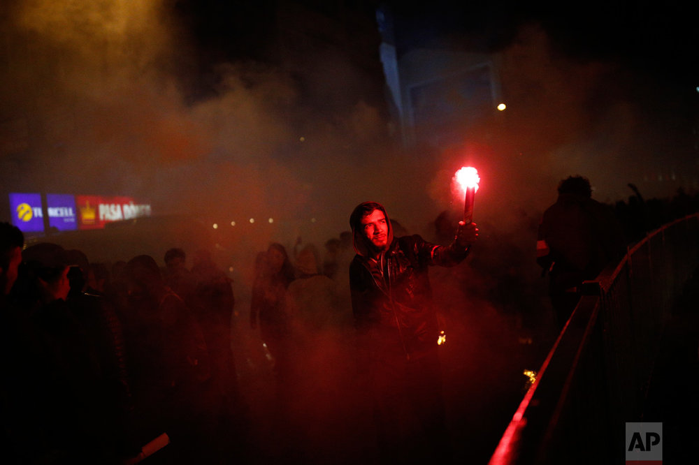 "A supporter of the ""No"" vote lights a flare during a protest in Istanbul, Turkey, against the results of the country's referendum, Monday, April 17, 2017. On Monday, the main opposition party urged the country's electoral board to cancel the results of a landmark referendum that granted sweeping new powers to President Recep Tayyip Erdogan, citing what it called substantial voting irregularities. (AP Photo/Emrah Gurel)"