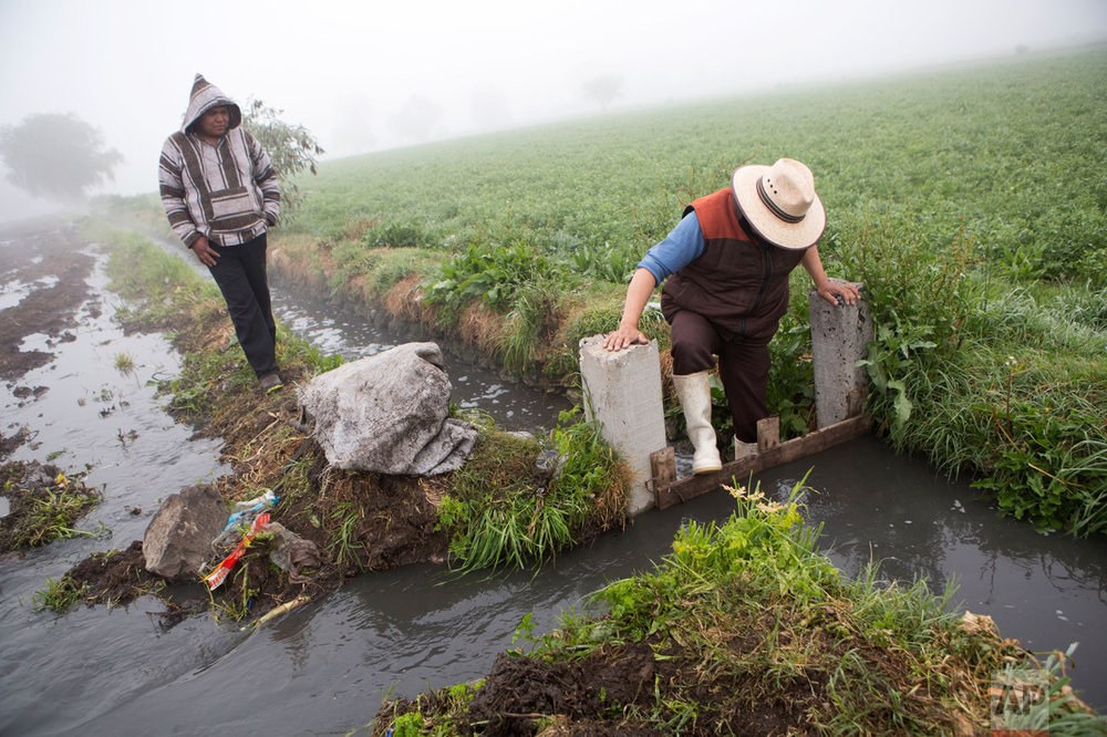 In this March 17, 2017 photo, a worker dams off a canal to divert wastewater onto a field where corn will be planted, in Santa Ana Ahuehuepan, north of Tula, Hidalgo state, Mexico. It's a standoff that pits public health concerns, not just for valley residents but for the Mexicans elsewhere who eat the crops, against fears that family farms will go under if they lose access to the raw sewage. (AP Photo/Rebecca Blackwell)