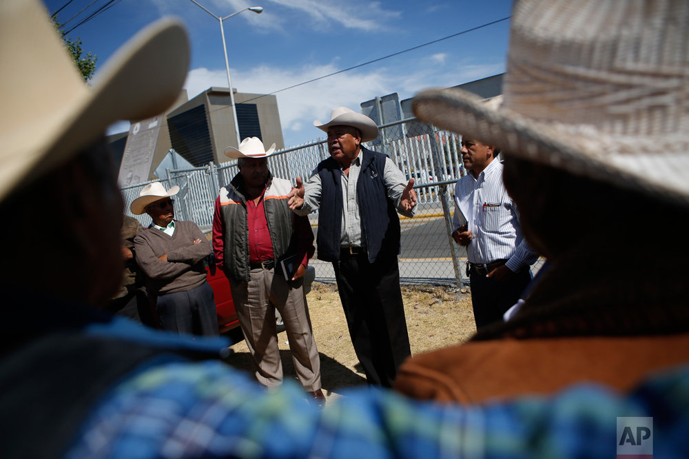 "In this Feb. 15, 2017 photo, members of the ""Council of Users in Defense of the 'Aguas Negras'"" talk with other farmers representing their communities as they prepare for a meeting with elected deputies at the Hidalgo State legislature in Pachuca, Mexico. Farmers have been meeting with elected officials and the National Water Commission to present their concerns. But suspicions run deep, since water has long been a scarce and contentious resource in central Mexico. (AP Photo/Rebecca Blackwell)"