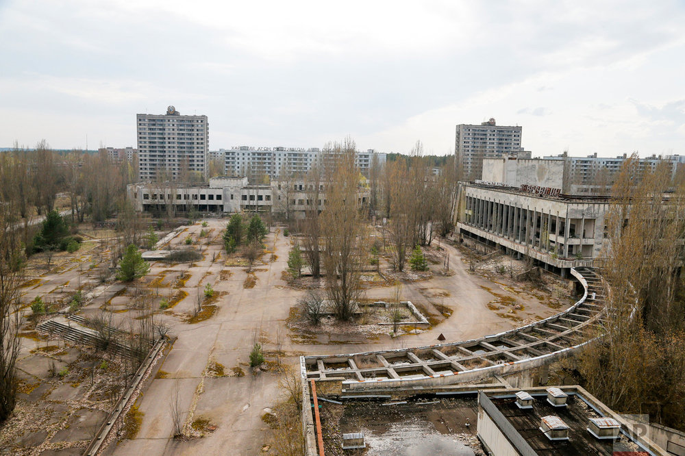 This photo taken Wednesday, April 5, 2017, shows a central square in the deserted town of Pripyat, some 3 kilometers (1.86 miles) from the Chernobyl nuclear power plant Ukraine. (AP Photo/Efrem Lukatsky)