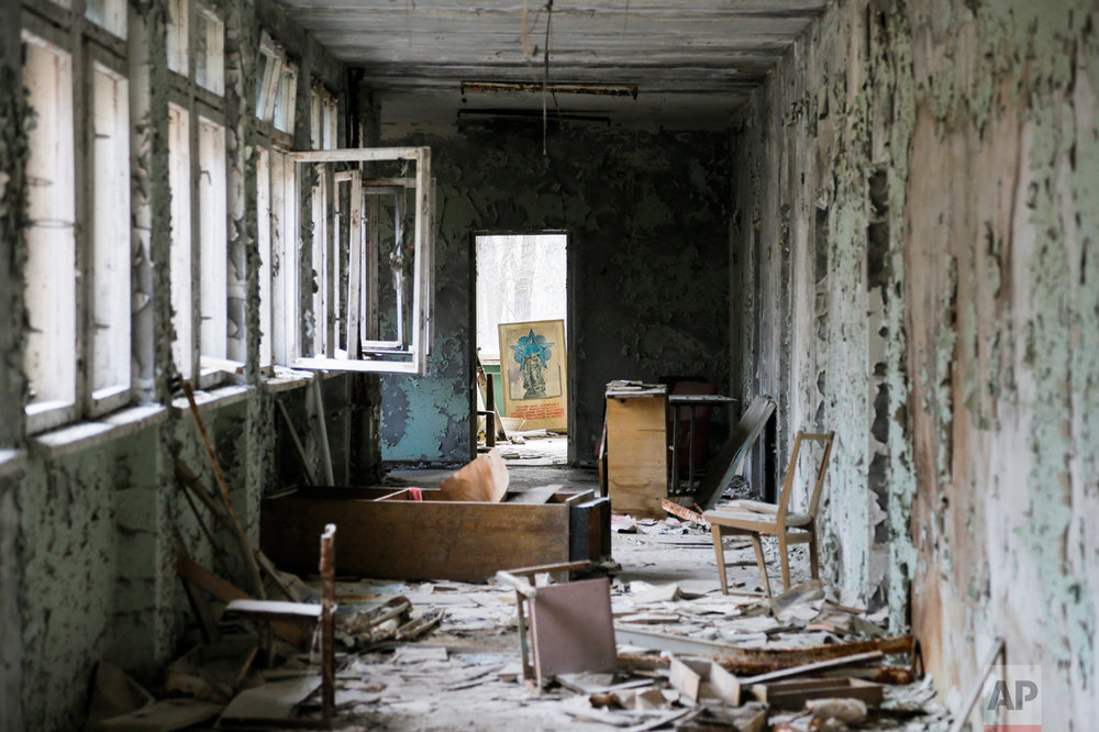This photo taken Wednesday, April 5, 2017, shows a room in a dilapidated building, part of a school in the deserted town of Pripyat, some 3 kilometers (1.86 miles) from the Chernobyl nuclear power plant Ukraine. (AP Photo/Efrem Lukatsky)