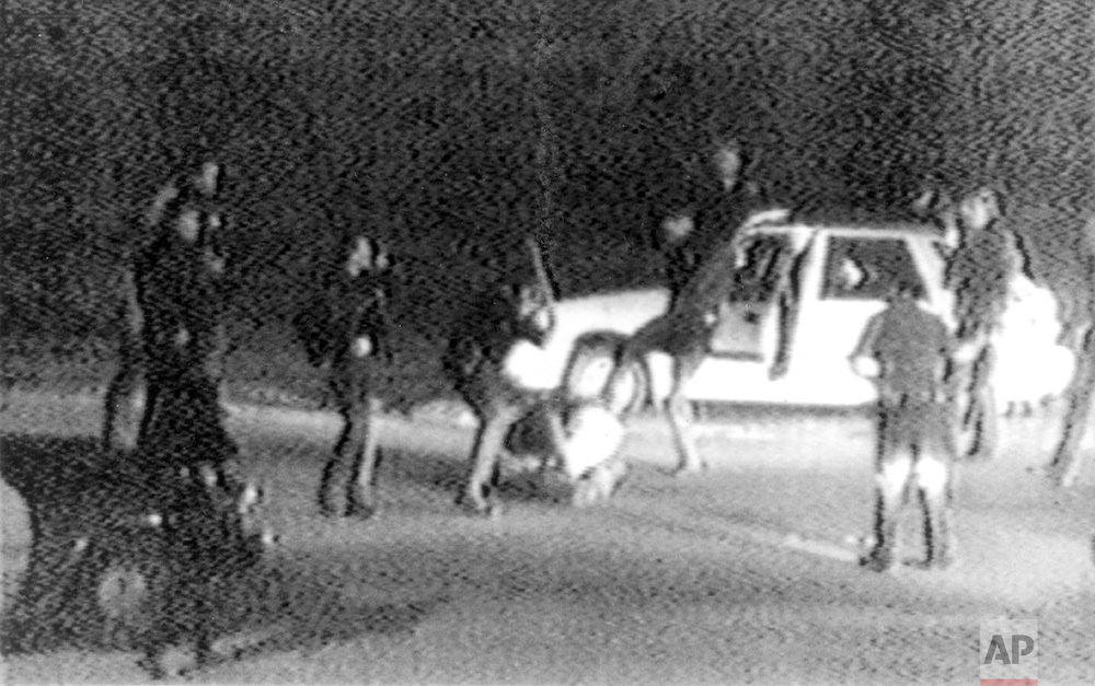 This March 3, 1991 image made from video provided by KTLA Los Angeles shows police officers beating Rodney King. King was pulled over by California Highway Patrol officers for speeding on a Los Angeles freeway. King, who later admitted he tried to elude authorities because he had been drinking and was on probation for a robbery conviction, pulled off the freeway and eventually stopped his car in front of a San Fernando Valley apartment building. At that point, Los Angeles police officers took charge of the traffic stop. George Holliday, who lived in the apartment building and was awakened by the noise, came out to videotape the scene. After Holliday turned the video over to a local TV station, it quickly spread and created an international outrage. (George Holliday/KTLA Los Angeles via AP)