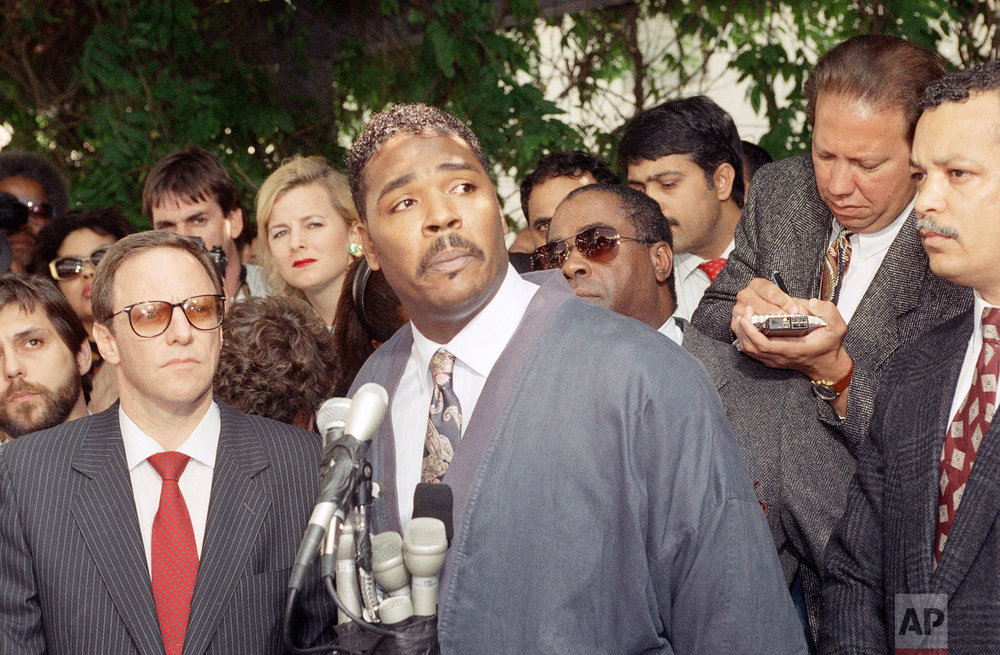 Rodney King makes a statement at a Los Angeles press conference, May 1, 1992, pleading for the end to the rioting and looting that has plagued the city following the verdicts in the trial against four Los Angeles Police officers accused of beating him. It was King's first public appearance since last year. (AP Photo/David Longstreath)