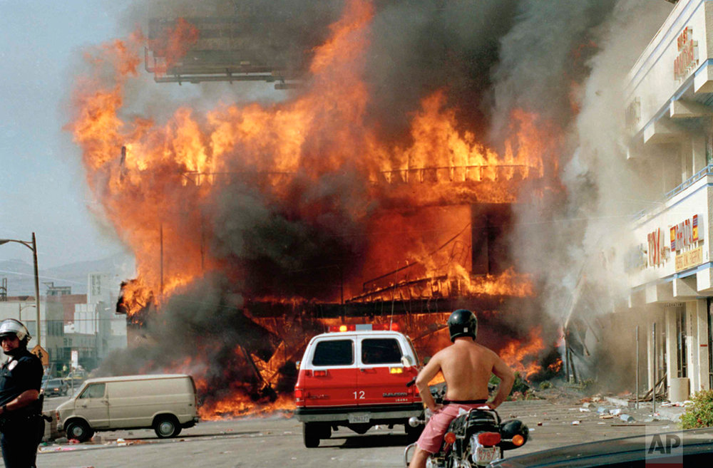 A Korean shopping mall burns at Thrid Street and Vermont Avenue in Los Angeles Thursday, April 30, 1992 on the second day of rioting in the city following the Rodney King assault. (AP Photo/Nick Ut)
