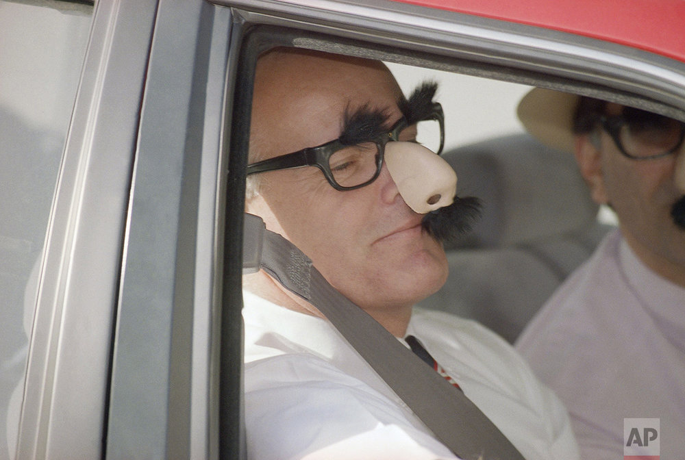 Stacey Koon, left, and his attorney Ira Salzman, both wearing gag glasses, arrive at Los Angeles federal court on Wednesday, April 14, 1993 where jurors will begin their fifth day of deliberations in the Rodney King civil rights case. (AP Photo/Bob Galbraith)