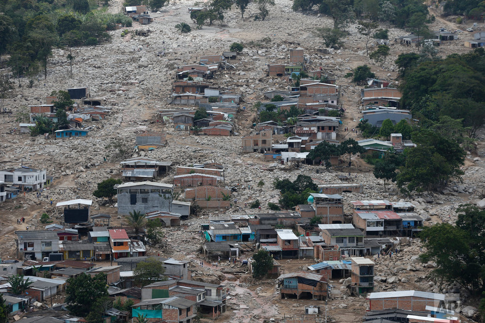 Destroyed homes are seen from the air in Mocoa, Colombia, Tuesday, April 4, 2017. Colombian authorities said at least 273 people were killed when rivers surrounding Mocoa overflowed and sent a wall of water and debris surging through the city over the weekend. The death toll was expected to rise since many more were missing and bodies are still being found. (AP Photo/Fernando Vergara)