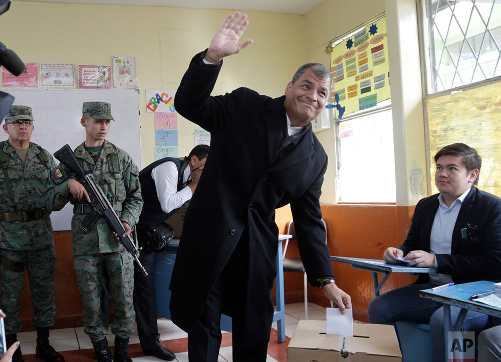 Ecuador's President Rafael Correa casts his ballot during presidential elections Quito, Ecuador, Sunday, April 2, 2017.  Polls showed a neck-and-neck vote between President Rafael Correa's hand-picked successor, Lenin Moreno, and conservative former banker Guillermo Lasso.(AP Photo/Dolores Ochoa)