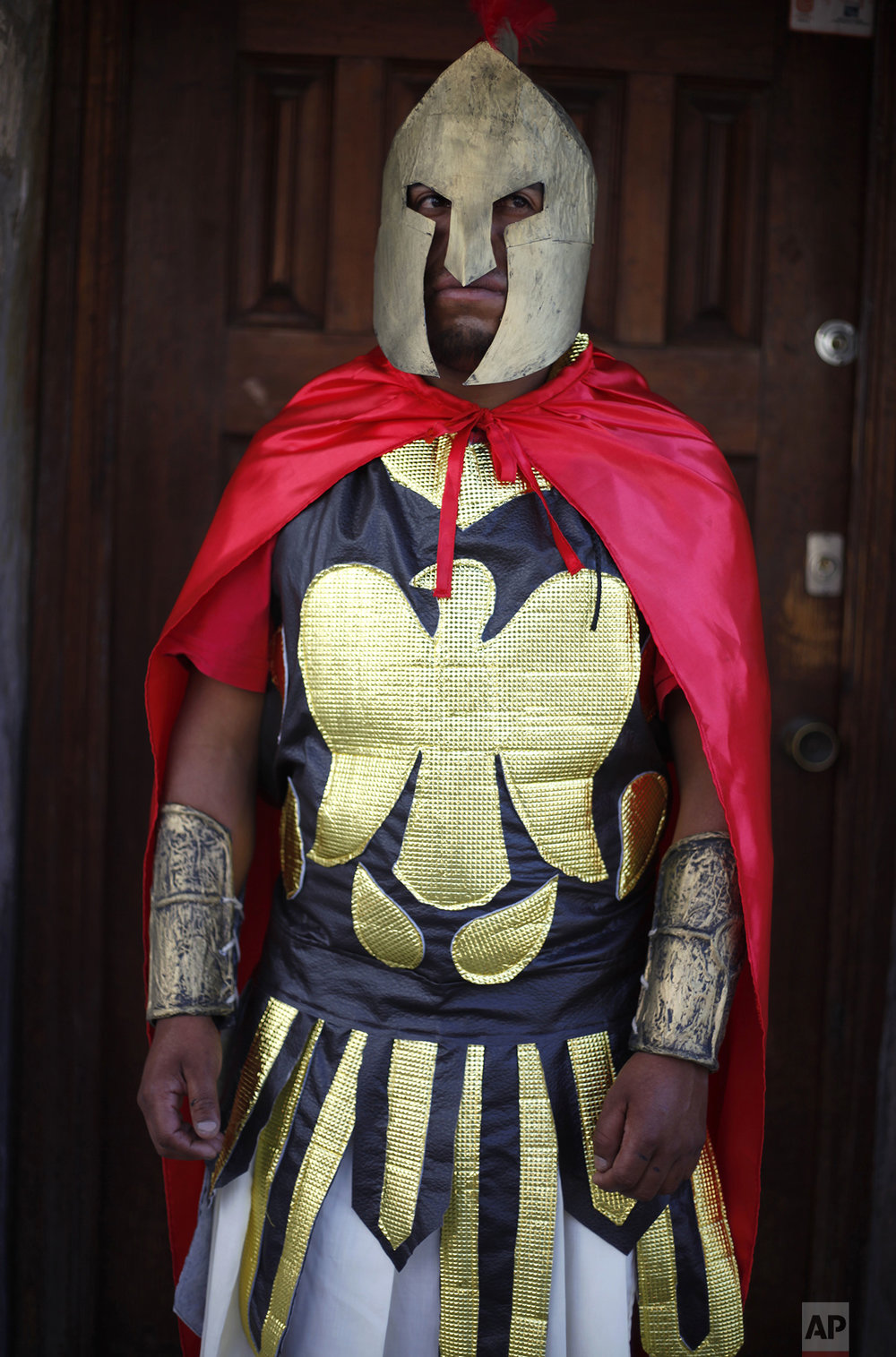 A local resident poses for a portrait dressed as a Roman soldier before participating in a reenactment of the Via Crucis, or Way of the Cross, in the village of San Mateo, some 50 km north of Mexico City, Mexico, Friday, April 14, 2017. Holy Week commemorates the last week of the earthly life of Jesus Christ culminating in his crucifixion on Good Friday and his resurrection on Easter Sunday. (AP Photo/Marco Ugarte)