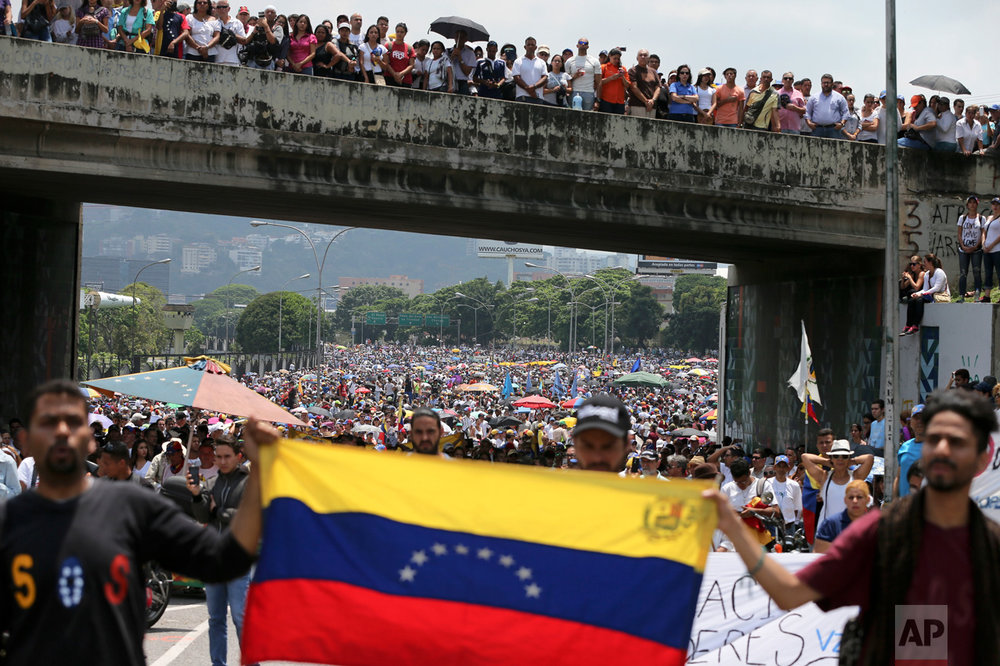 In this Monday, April 24, 2017 photo, anti-government protesters block a highway in Caracas, Venezuela. President Nicolas Maduro has repeatedly called for renewed talks between the two sides, but opposition leaders have discarded that as an option after earlier talks collapsed in December. (AP Photo/Fernando Llano)