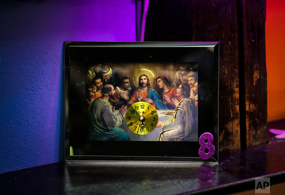 In this Thursday, May 4, 2017, photo a quartz clock icon is on display in the religion kitsch section of the newly opened Bucharest Kitsch Museum, in Bucharest, Romania. (AP Photo/Vadim Ghirda)