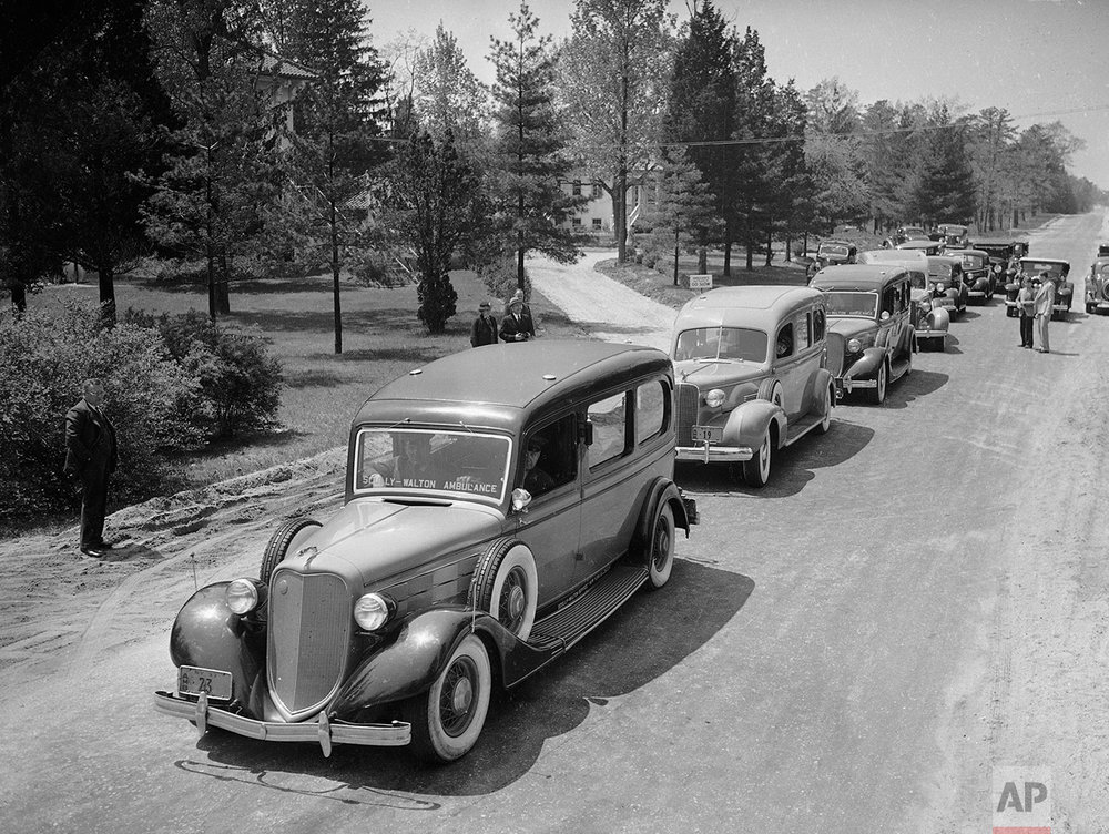 In this May 7, 1937 photo, ambulances line up to transfer hospitalized victims of the Hindenburg disaster the previous day to other area hospitals from Paul Kimball Hospital, in Lakewood, N.J.  (AP Photo)