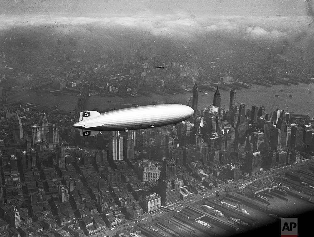 The German zeppelin Hindenburg flies over Manhattan on May 6, 1937.  A few hours later, the ship burst into flames in an attempt to land at Lakehurst, N.J.  (AP Photo)