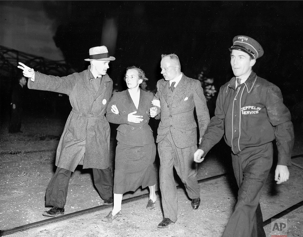 An unidentified woman survivor is being led from the scene of the Hindenburg disaster at the U.S. Naval Station in Lakehurst, N.J., May 6, 1937.  (AP Photo/Murray Becker)