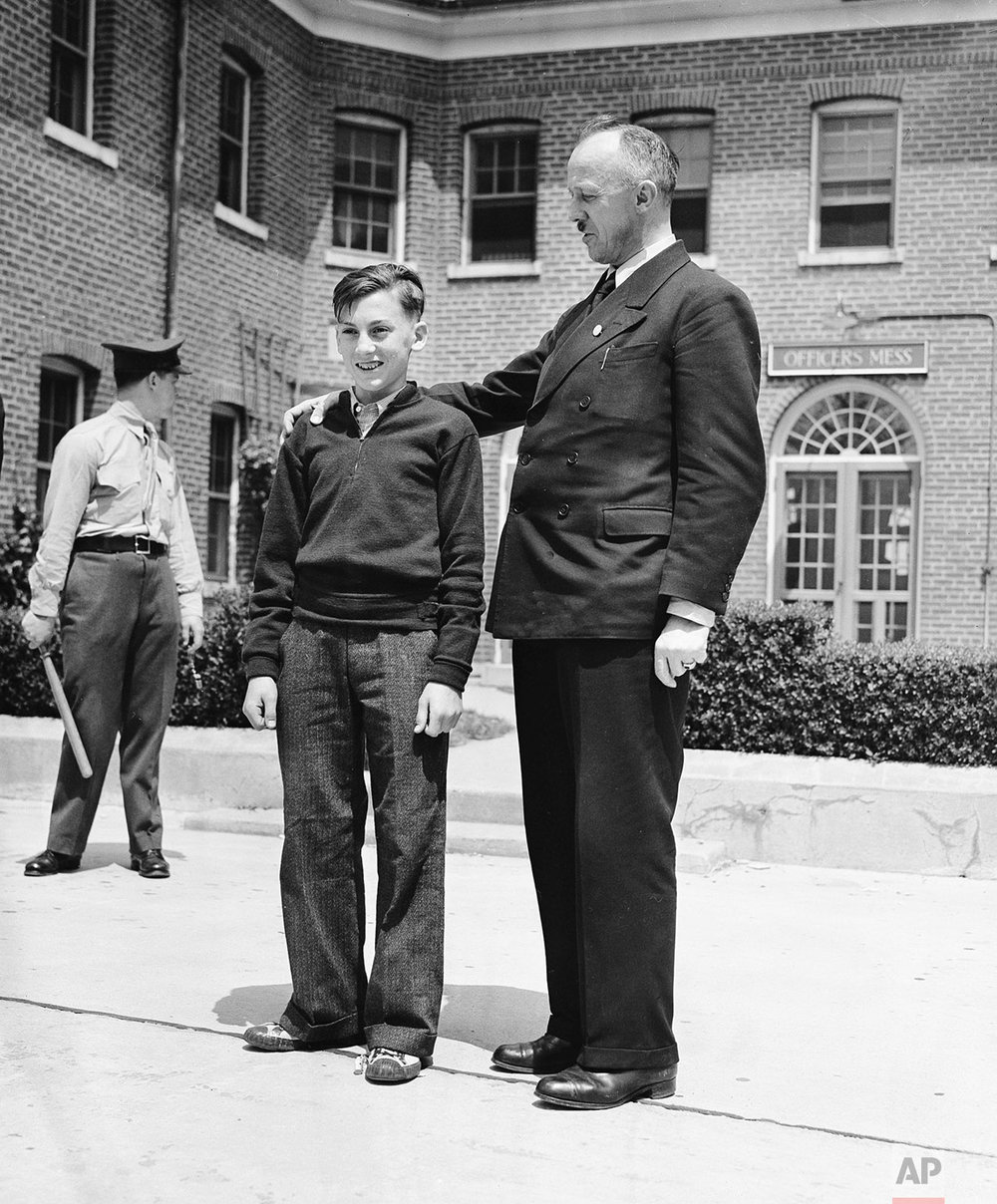 Two survivors of the Hindenburg disaster, 13-year-old Werner Franz, cabin boy, and Heinrich Kubis, a steward, are shown in Lakehurst, N.J., May 7, 1937. (AP Photo)