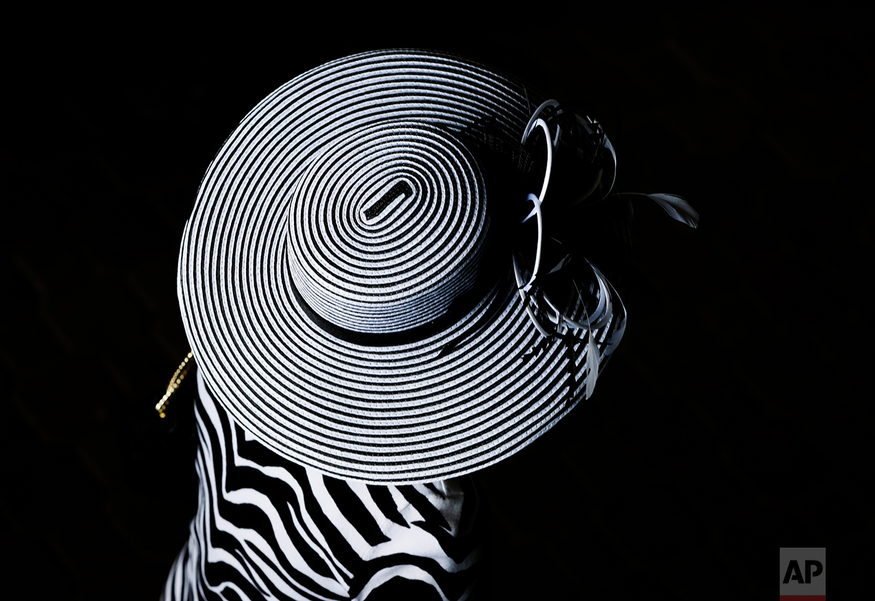A woman wears a fancy hat before the 143rd running of the Kentucky Derby  horse race cbad9d5577f2