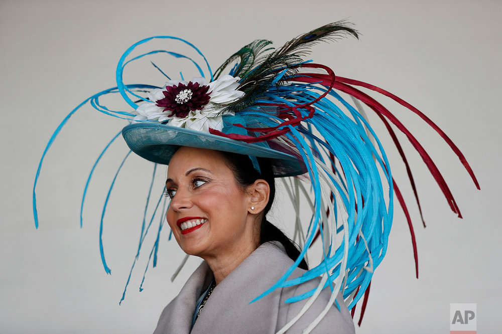 A woman wears a fancy hat before the 143rd running of the Kentucky Derby horse race at Churchill Downs Saturday, May 6, 2017, in Louisville, Ky. (AP Photo/John Minchillo)