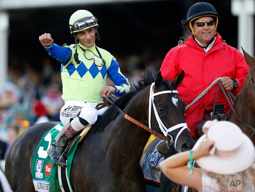 John Velazquez celebrates after riding Always Dreaming to victory in the 143rd running of the Kentucky Derby horse race at Churchill Downs Saturday, May 6, 2017, in Louisville, Ky. (AP Photo/John Minchillo)