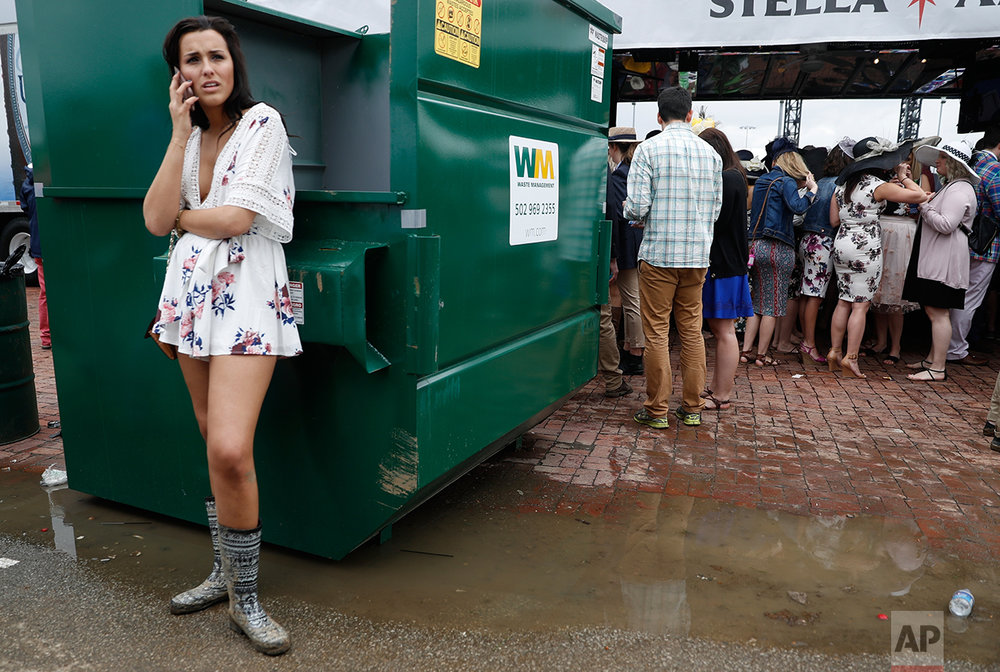 A fan talks on her phone in the infield before the 143rd running of the Kentucky Derby horse race at Churchill Downs Saturday, May 6, 2017, in Louisville, Ky. (AP Photo/John Minchillo)