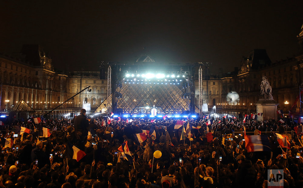 "French President-elect Emmanuel Macron speaks during a victory celebration outside the Louvre museum in Paris, France, Sunday, May 7, 2017. Speaking to thousands of supporters from the Louvre Museum's courtyard, Macron said that France is facing an ""immense task"" to rebuild European unity, fix the economy and ensure security against extremist threats. (AP Photo/Thibault Camus)"
