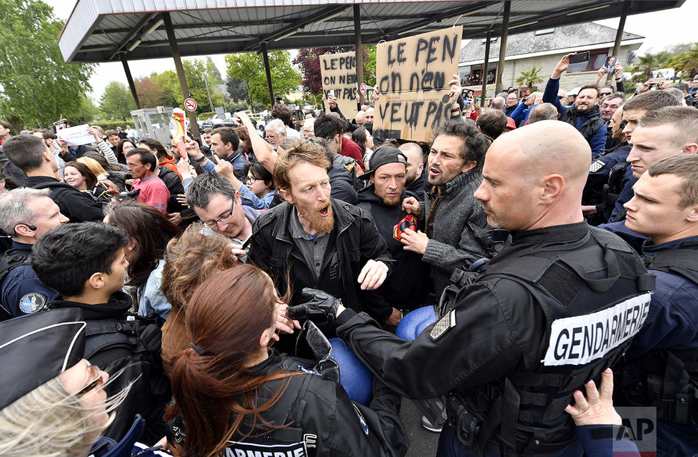 French Gendarmes control protestors far-right presidential candidate Marine Le Pen as she faces hostile reception from protesters in Dol-de-Bretagne, Brittany, Thursday May 4, 2017.  (AP Photo)