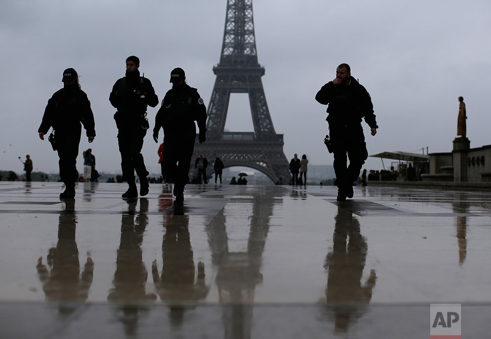 French police officers patrol on the esplanade of the Trocadero in Paris, France Sunday, May 7, 2017. (AP Photo/Emilio Morenatti)