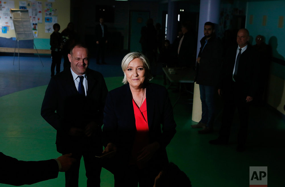French far-right presidential candidate, Marine Le Pen smiles after casting her ballot in Henin Beaumont, France, Sunday, May 7, 2017. (AP Photo/Francois Mori)