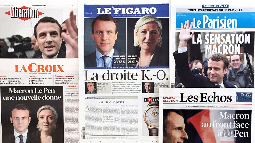 A montage of French national newspaper front pages reporting on the winners of the first round of the French presidential election, centrist candidate Emmanuel Macron and far-right candidate Marine Le Pen, are displayed in Paris, France, Monday, April 24, 2017. (AP Photo/Laurent Rebours)