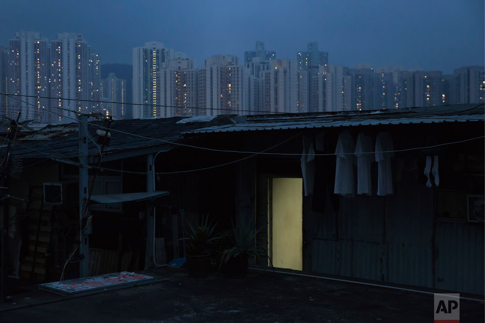 "In this Saturday, May 6, 2017 photo, an illegal rooftop hut is seen in Hong Kong.  There's a dark side to the property boom in wealthy Hong Kong, where hundreds of thousands of people priced out of the market must live in partitioned apartments, ""coffin homes"" and other inadequate housing. As a new leader for the territory prepares to take office, housing unaffordability remains one of the Asian financial center's biggest social problems. (AP Photo/Kin Cheung)"