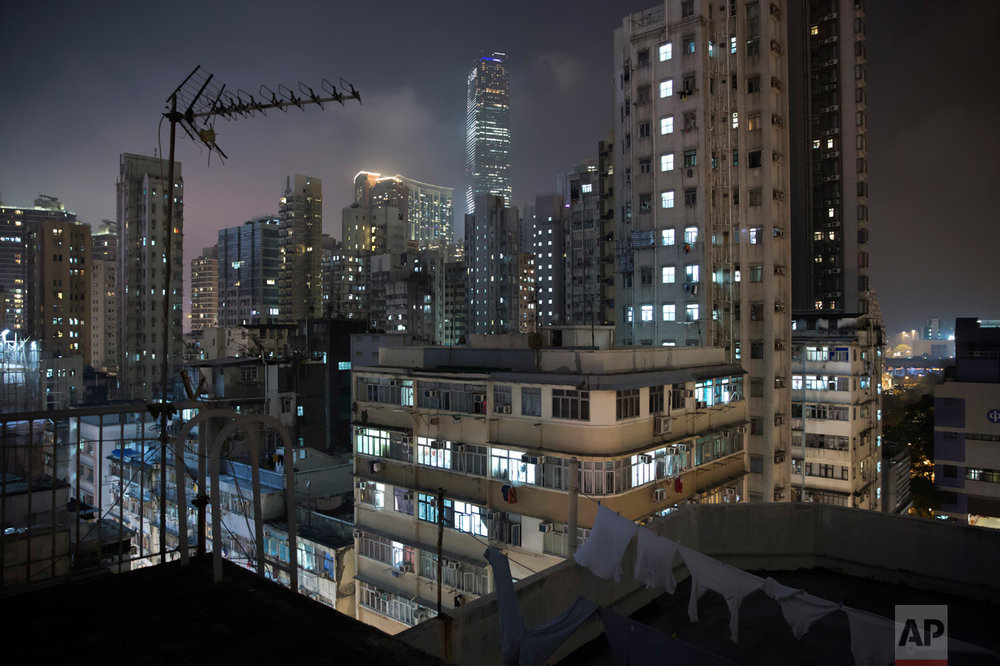 "This May 6, 2017 photo shows a general view of residential and commercial buildings in Yau Tsim Mong District, a popular location for the ""subdivided units"" in Hong Kong. There's a dark side to the property boom in wealthy Hong Kong, where hundreds of thousands of people priced out of the market must live in partitioned apartments, ""coffin homes"" and other inadequate housing. As a new leader for the territory prepares to take office, housing unaffordability remains one of the Asian financial center's biggest social problems. (AP Photo/Kin Cheung)"
