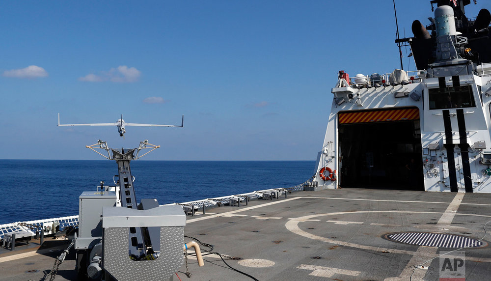 In this Saturday, Feb. 25, 2017 photo, the ScanEagle unmanned aerial vehicle takes off from the flight deck of the U.S. Coast Guard cutter Stratton somewhere in the eastern Pacific Ocean. The Boeing-made ScanEagle, was deployed aboard the Stratton for the first time during this three-month mission. (AP Photo/Dario Lopez-Mills)