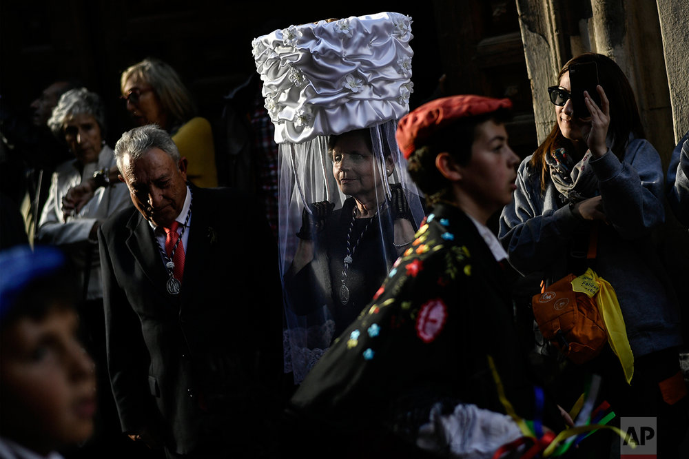 "Participants of the ""Prioress Procession"" take part in the ceremony in honor of Domingo de La Calzada Saint (1019-1109), who helped poor people and pilgrims, in Santo Domingo de La Calzada, northern Spain, Wednesday, May 10, 2017. (AP Photo/Alvaro Barrientos)"