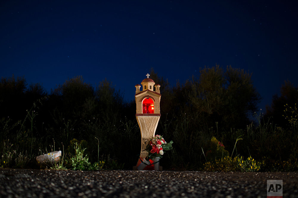 In this photo taken on Wednesday, April 26, 2017, a roadside shrine stands near the village of Paleovarvasena, in the Peloponnese region of southern Greece. (AP Photo/Petros Giannakouris)