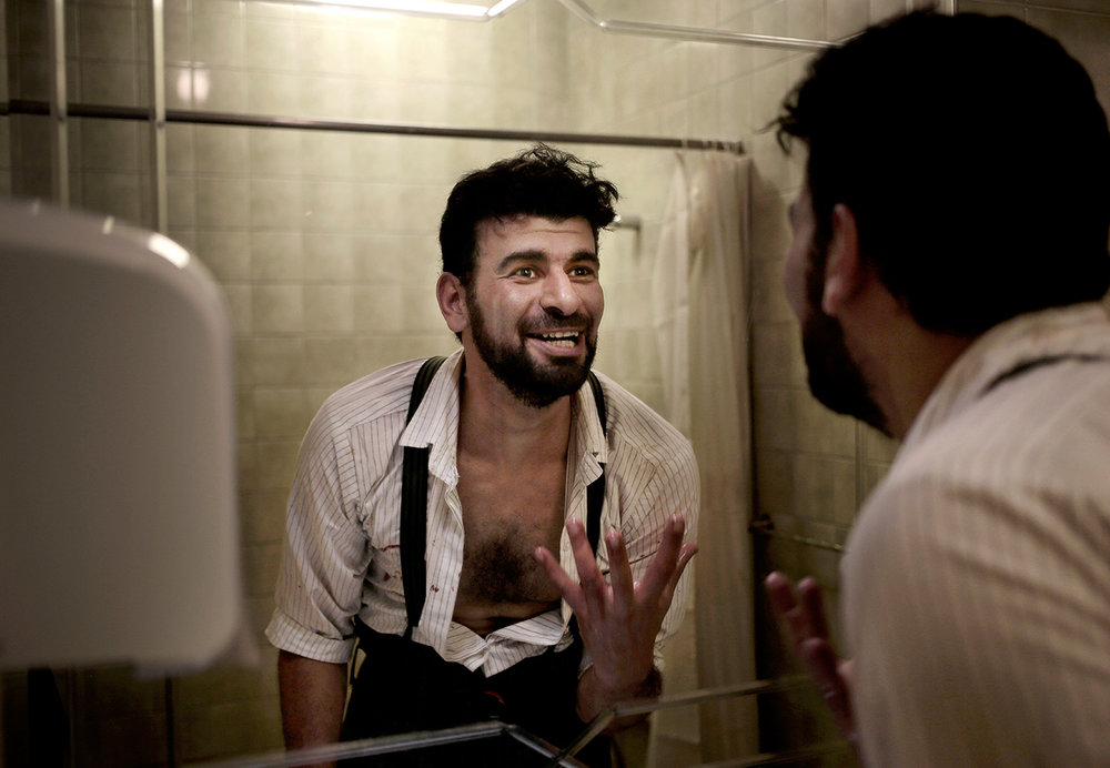 In this March 28, 2017 photo, Egyptian ballet dancer Hani Hassan, looks at the mirror as he talks to himself in the washroom, after performing 'Zorba' in his dressing room during the opening night, at Egypt's Cairo Opera House. (AP Photo/Nariman El-Mofty)